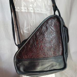 A vintage leather dream kidney shape crossbody bag